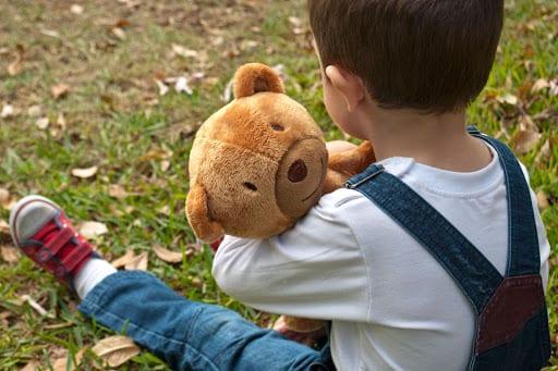 boy hugging teddy
