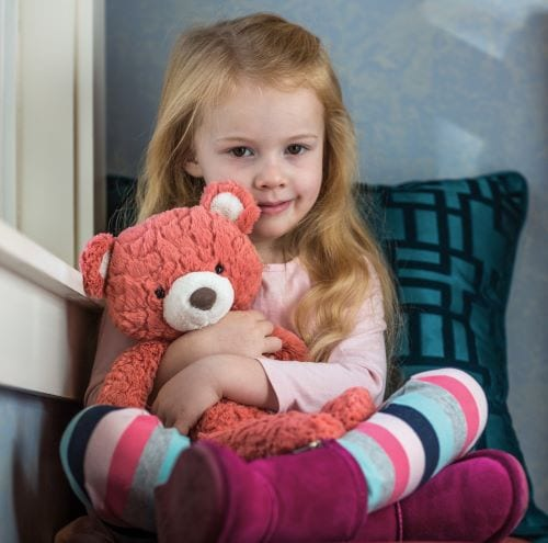 coral teddy with little girl
